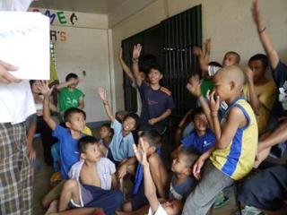 all raising hands.jpg